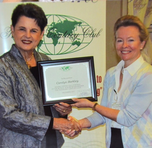 Carolyn receives the SILVER AWARD from the Traveler's Century Club (TCC), USA & International for visiting 154 countries. Presenting it to her is Kim-Kay Randt, (right)  leader of the Texas delegation to TCC.