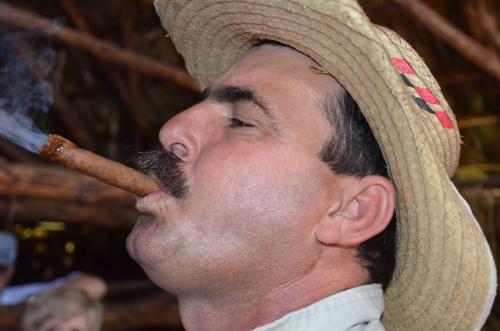 Benito showed us a trick of putting the burning end of the cigar into his mounth and blowing out the other end, causing a huge stream of smoke.