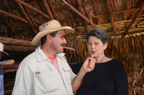 Benito tells me I have to draw on the cigar to get it going. Photo by June.