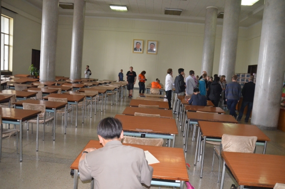 A North Korean man reads inside the Grand People's Study Palace