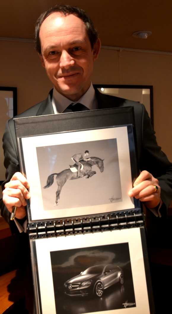 Gorge Hayter, Harcourt Sales Manager, with the photo of the polo player on his horse, and a car.