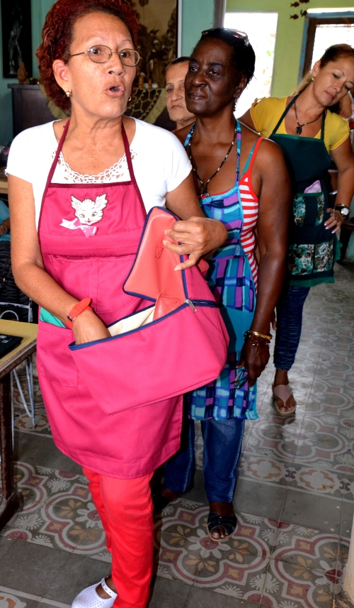 Ladies in need of extra income joined the sewing group and made aprons, dolls and other objects for sale.