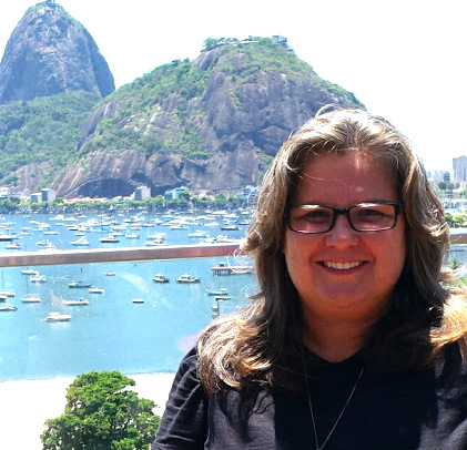 Sonia Lima, our fun and expert Rio city guide on our Tauck Events tour, with Rio's Sugar Loaf Mountain and Bay.