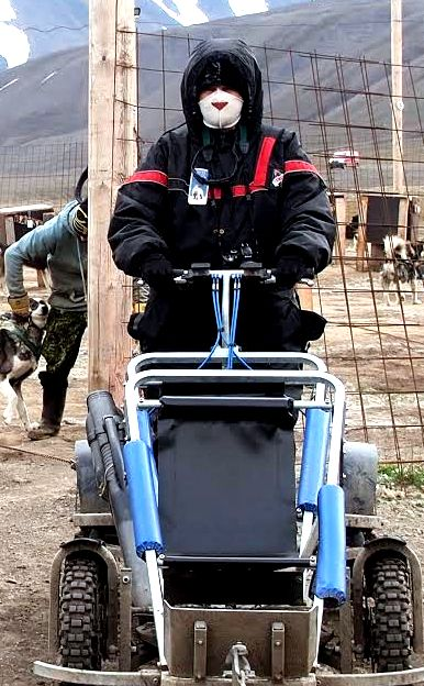 June took this photo of me holding the cart brake down so it wouldn't move as the dogs were hitched to the team.