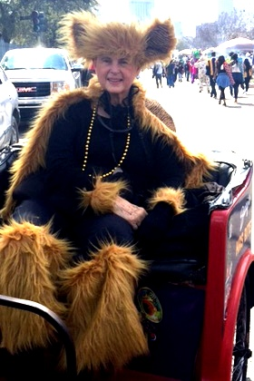 Carolyn waistup in pedicab at Mardi Gras 2017